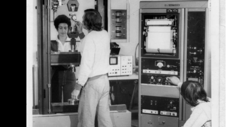 Angie Spano, Tony Macken and Trinh Cao with testing equipment, and 1970s trousers